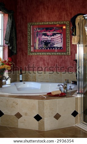 tiled garden bath tub with a glass shower in ruby red bathroom - stock photo