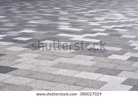 Tiled mosaic concrete pavement  - stock photo