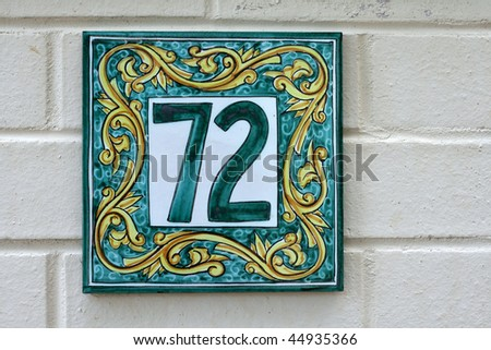 tiled number seventy two sign for home - stock photo