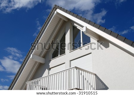 tiled roof and windows against a blue sky