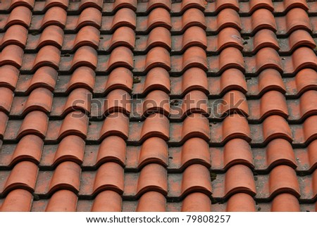 tiled roof on the top of the house - stock photo