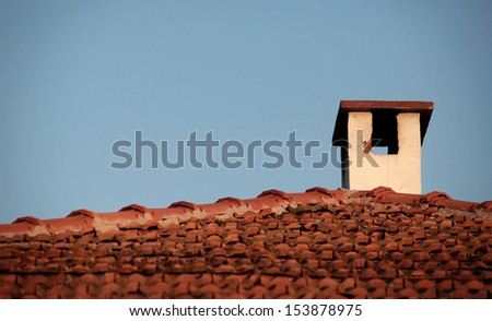 Tiled roof with chimney in Bulgarian village