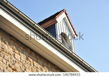 Tiled Roof with Dormer Window and Eaves Gutter