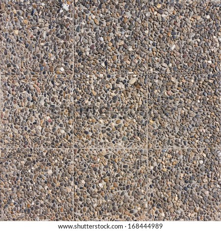 Tiled seamless mosaic concrete pavement of the road - stock photo