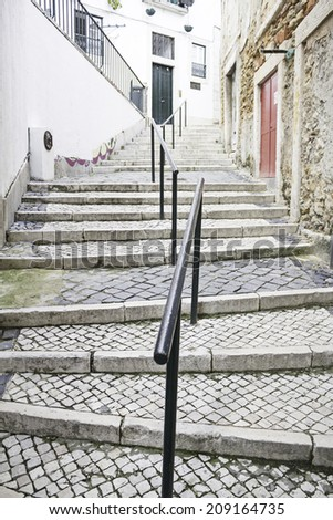 Tiled Stairs and houses in urban road construction - stock photo