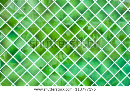 Tiled wall with bunch of green tiles
