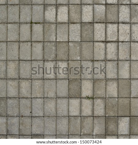 Tiled with paving stone bricks path's fragment as an abstract background