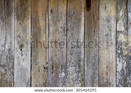 Tiled wooden wall with old gray aspect