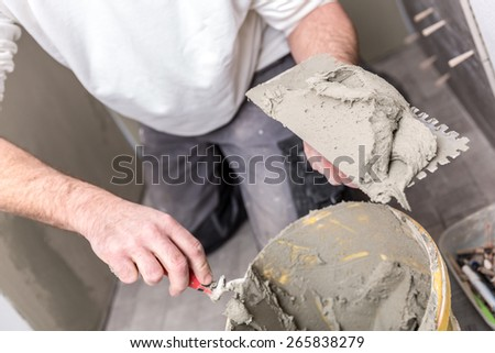 tiler at work - stock photo