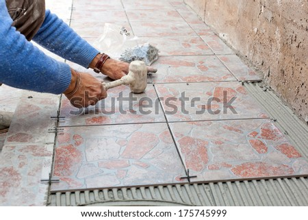 Tiler to work with tile flooring for garden - stock photo
