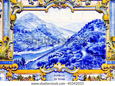 tiles (azulejos) at railway station of Pinhao, Douro Valley, Portugal - stock photo