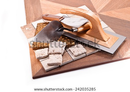 Tiles for floors and walls, trowel, spatulas on a white background - stock photo