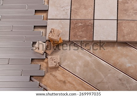 Tiles made of ceramic, stone and aluminum - stock photo