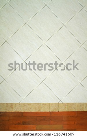 Tiles pattern joined with wooden parquet - stock photo