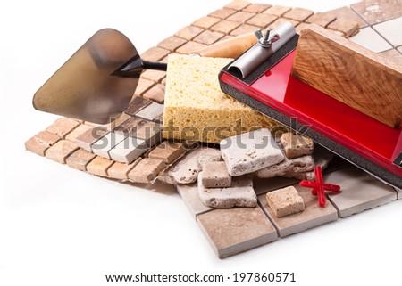 Tiles, trowel, sponge, tool with sandpaper on white background - stock photo