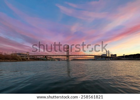 Tilikum Crossing and Ross Island Bridge Over Willamette River in Portland Oregon during Sunset - stock photo