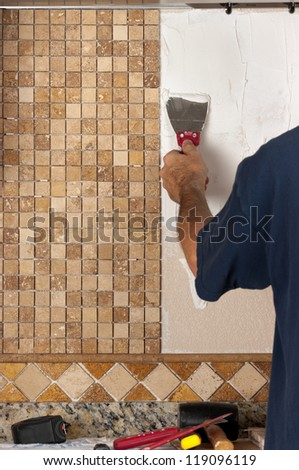 Tiling backsplash - stock photo