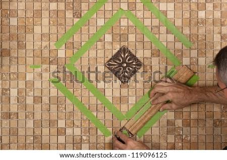 Tiling backsplash - stock photo