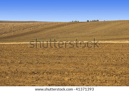 Tilled dirt field in the Colorado prairie in winter - stock photo