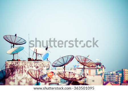 Tilt shift blur effect. Abstract Yangon cityscape with parabolic satellite dishes at building roofs. Myanmar (Burma) travel landscapes and destinations - stock photo