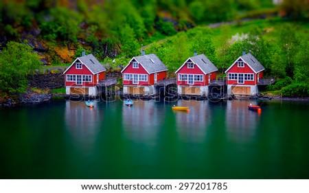 tilt shift effect on some boat houses - stock photo