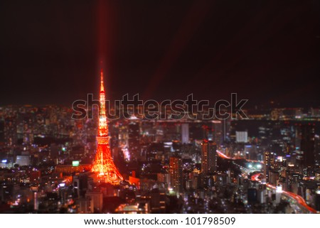 Tilt-shift (fake miniature) of Tokyo Tower at night; one of Japan's most iconic landmarks. - stock photo