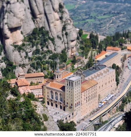 Tilt-shift Miniature of Santa Maria de Montserrat Monastery in Catalonia, Spain - stock photo