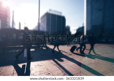 Tilt shift of people walking outdoor on the sidewalk in the city - commute, business, work concept - stock photo