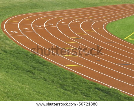 Tilted view of curve in eight-lane track for collegiate runners - stock photo