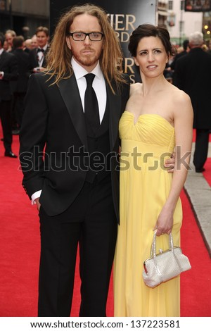Tim Minchin and Sarah Minchin arriving for the Laurence Olivier Awards 2013 at the Royal Opera House, Covent Garden, London. 28/04/2013