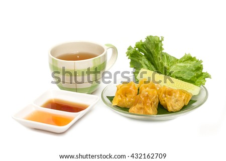 Tim sum or Dim sum.(Steamed pork dumpling) with sauce and tea isolated on white background - stock photo