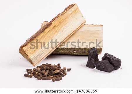 Timber, coal and biomass pellet on white background. - stock photo