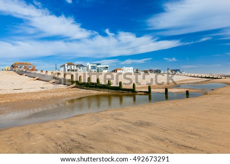 Timber Groynes on the Golden sandy beach at Camber Sands East Sussex England UK Europe