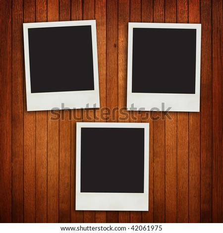 Timber wall background with retro photo frames