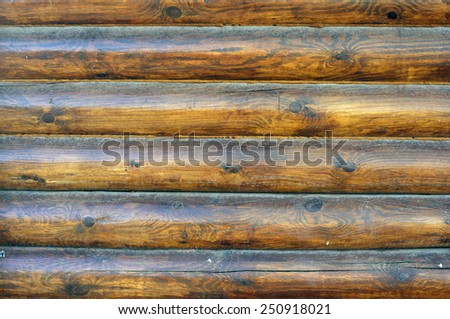 Timber wall. The wall built from natural logs laid horizontally - stock photo