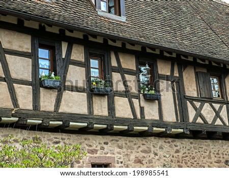 Timbered upper-structure in the medieval village of Riquewihr in the Alsace northeastern region of France