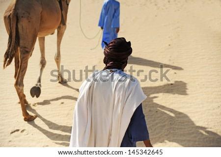 timbuktu desert walking - stock photo