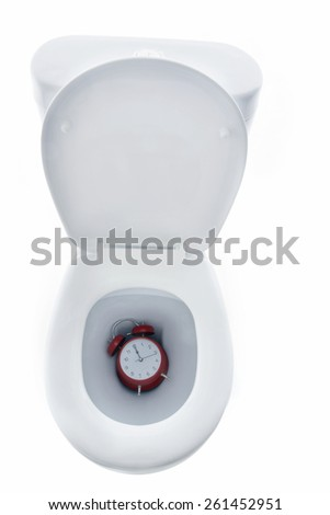 Time and Deadlines down the toilet - stock photo