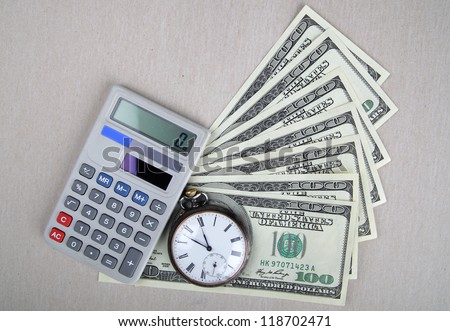 Time and Money concept image.  Close-up of dollars, vintage watch and calculator. - stock photo