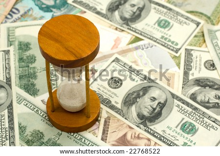 Time And Money Concept image - sand watch and background of money. - stock photo
