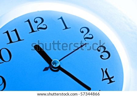 Time background: blue wall clock - stock photo