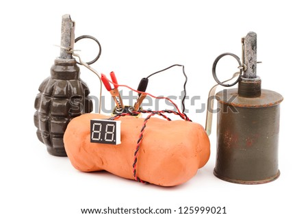 Time bomb made of explosives isolated on white - stock photo