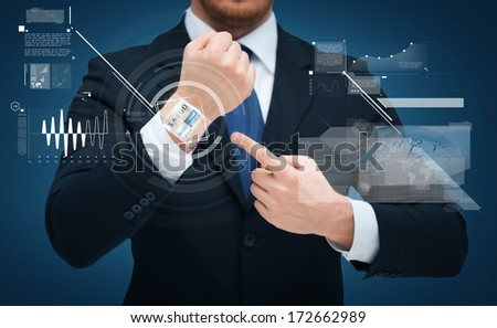 time, business and new technology concept - close up of businessman pointing to something at his hand - stock photo