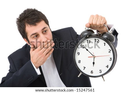 time concept in business with surprised businessman and clock, focus on clock face