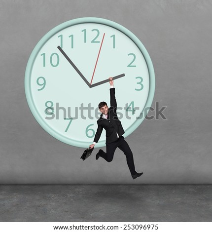 Time concept. Man hanging on a clock - stock photo