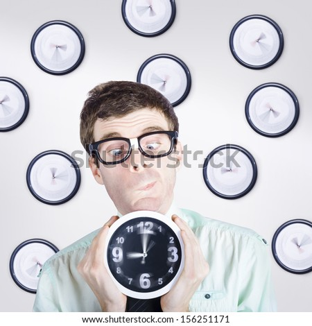 Time concept of a business man standing with clock in hand while making a choice between the past present and future - stock photo