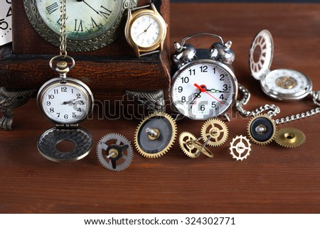 Time concept. Set of various clocks and watches with gears - stock photo