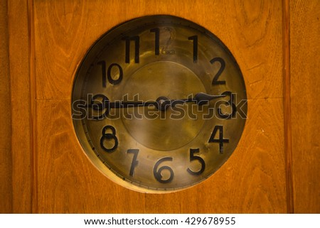 Time concept - vintage clock face with grunge texture and old text - stock photo