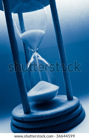 time concept with hourglass blue tinted - stock photo