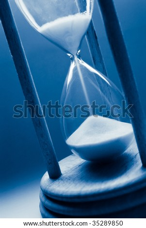 time concept with hourglass in blue tint - stock photo